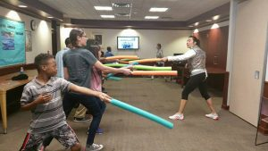 Teens at the Lincoln Library learning to fence.